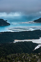 Moody scene with clouds rolling over Whanganui Inlet after sunset, Nelson Region, South Island, New Zealand