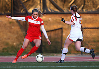 COLLEGE PARK, MARYLAND - April 03, 2013:  Stephanie Ochs (22) of The Washington Spirit pushes the ball away from Shannon Collins (73)  of the University of Maryland women's soccer team in a NWSL (National Women's Soccer League) pre season exhibition game at Ludwig Field in College Park Maryland on April 03. Maryland won 2-0.