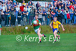 Gary O'Leary Kilcummin drives past Danny Healy Beaufort  during their IFC clash in Kilcummin on Saturday