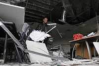 "Gaza.10.01.2008Palestinian worker inspects a damaged classroom at the American School in Gaza City 10 January 2008. The school was hit by a rocket propelled grenade (RPG) around midnight by unknown assailants.""photo by Fady Adwan"