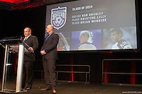 San Francisco, CA - Saturday Feb. 14, 2015: (Left to right): Kasey Keller watches as Matt McBride introduces  US Soccer player Brian McBride.  Brian McBride was inducted into the hall of fame at the 2014 US Soccer Hall of Fame Induction ceremony.