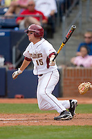 Tyler Holt #15 of the Florida State Seminoles follows through on his swing versus the Georgia Tech Yellow Jackets at Durham Bulls Athletic Park May 23, 2009 in Durham, North Carolina.  (Photo by Brian Westerholt / Four Seam Images)
