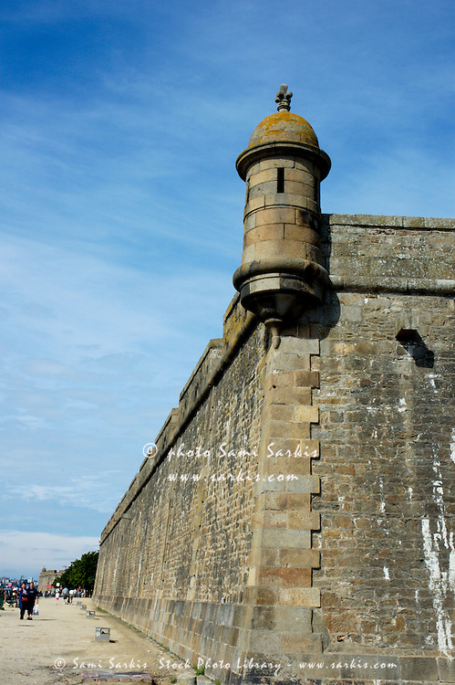 Stone ramparts with small angle tower in Saint Malo, Brittany, France.