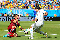 Italy goalkeeper Gianluigi Buffon saves a shot from Luis Suarez of Uruguay