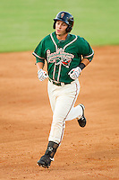 Justin Bass #14 of the Greensboro Grasshoppers rounds the bases after hitting a home run at Fieldcrest Cannon Stadium August 3, 2010, in Kannapolis, North Carolina.  Photo by Brian Westerholt / Four Seam Images
