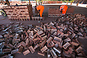 01/10/15<br /> <br /> Men check and stack some of the 18,000 bricks they are each due to move today.<br /> <br /> ***Full story here:  http://www.fstoppress.com/articles/london-bricks/  ***<br /> <br /> Triathletes have recently coined the term 'brick workout' to describe their gruelling training regime when running, following tough sessions on their bicycles.<br /> <br /> But one group of workers have been using their very own 'brick workout' for decades, without the need for lycra, personal trainers or lightweight bicycles.<br /> <br /> But one group of workers have been using their very own 'brick workout' for decades, without the need for lycra, personal trainers or lightweight bicycles.<br /> <br /> These men, 21 on every shift, each pick-up, inspect, and re-stack 18,000 London Bricks every day.<br /> <br /> One brick weighs 2 kg – so each man lifts the equivalent of almost 40 tons every day at the brick works, near Peterborough, where 2.8 million bricks are made each week.<br /> <br /> All Rights Reserved: F Stop Press Ltd. +44(0)1335 418365   www.fstoppress.com.