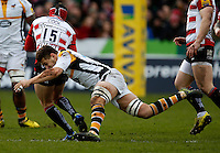 Photo: Richard Lane/Richard Lane Photography. Gloucester Rugby v Wasps. Aviva Premiership. 05/03/2016. Wasps' Sam Jones tackles Gloucester's Rob Cook.