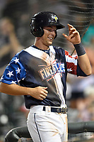 Designated hitter Colby Woodmansee (26) of the Columbia Fireflies is greeted after scoring a run in a game against the Rome Braves on Monday, July 3, 2017, at Spirit Communications Park in Columbia, South Carolina. Columbia won, 1-0. (Tom Priddy/Four Seam Images)