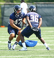 Virginia linebacker Bill Schautz(47) and Virginia running back Max Milien during open spring practice for the Virginia Cavaliers football team August 7, 2009 at the University of Virginia in Charlottesville, VA. Photo/Andrew Shurtleff