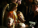 It was standing room only at the last Mass at St. John Cantius in Detroit, Sunday, Oct. 28, 2007. Here, Jillian Kalis,7, of Wyandotte leans on one of the angels holding holy water at the back of the church where her and her family found a place to stand.