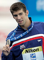 U.S. Michael Phelps shows the gold medal after setting the new world record clocking 49.82 in the Men's 100m Butterfly final at the Swimming World Championships in Rome, 1 August 2009..UPDATE IMAGES PRESS/Riccardo De Luca
