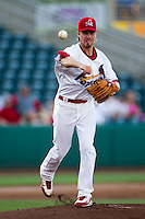 Scott Schneider (29) of the Springfield Cardinals throws to first during a game against the Tulsa Drillers at Hammons Field on July 18, 2011 in Springfield, Missouri. Tulsa defeated Springfield 13-8. (David Welker / Four Seam Images)