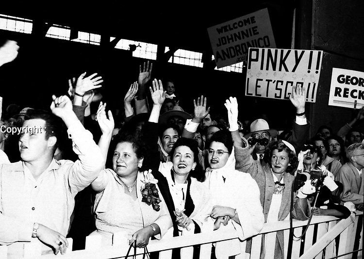 The families of the returning POW's waving and greeting the ship the General Nelson M. Walker as it docks at Fort Mason, California.  August 23, 1953.  Pfc. Brink.  (Army)<br /> NARA FILE #:  111-SC-425769<br /> WAR & CONFLICT BOOK #:  1519