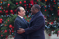 French President Francois Hollande greets Senegal's President Macky Sall (R) as he arrives at the Elysee Palace during a visit in Paris as part of his state visit to France, December 20, 2016. # FRANCOIS HOLLANDE RECOIT MACKY SALL, LE PRESIDENT DU SENEGAL, A L'ELYSEE