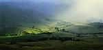 Shafts of light on Hawke's Bay farmland in  New Zealand.