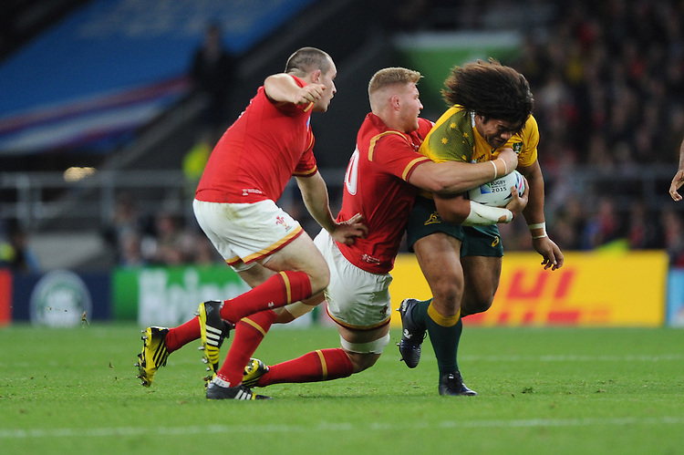 Tatafu Polota-Nau of Australia is tackled by Ken Owens and Ross Moriarty of Wales during Match 35 of the Rugby World Cup 2015 between Australia and Wales - 10/10/2015 - Twickenham Stadium, London<br /> Mandatory Credit: Rob Munro/Stewart Communications