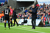 Paul Clement Manager of Reading shouts instructions to his team from the dug-out during the Sky Bet Championship match between Swansea City and Reading at the Liberty Stadium in Swansea, Wales, UK. 27th October, 2018