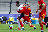 3rd September 2021; Newport, Wales:  Jordan James of Wales and Kaide Gordon of England battle for the ball during the U18 International Friendly match between Wales and England at Newport Stadium in Newport, Wales.