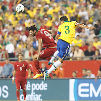 Portugal forward Nelson Oliveira (9) and Brazil defender Thiago Silva (3) battle for head ball. In an international friendly, Brazil (yellow/blue) defeated Portugal (red), 3-1, at Gillette Stadium on September 10, 2013.