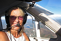 Sibylle Allgaier piloting Cessna Cardinal, N30765 over California's gold country