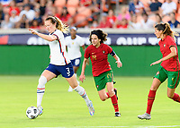 HOUSTON, TX - JUNE 10: Samantha Mewis #3 of the United States brings the ball up the field with Dolores Silva #14 of Portugal behind her during a game between Portugal and USWNT at BBVA Stadium on June 10, 2021 in Houston, Texas.