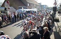 peloton racing through Ichtegem during the final local laps<br /> <br /> 3 Days of West-Flanders 2015<br /> stage 2: Nieuwpoort - Ichtegem 184km