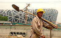 "Work is carried out on the new Olympic Stadium in Beijing, China. The structure locally known as the ""bird's nest"" and will be at the heart of track and field competitions and the opening and closing ceremonies for the  2008 Beijing Olympics..01 May 2007"