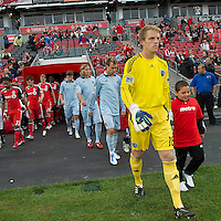 Sporting KC and Toronto FC enter the pitch during an MLS game between Sporting Kansas City and the Toronto FC at BMO Field in Toronto on June 4, 2011..The game ended in a 0-0 draw...