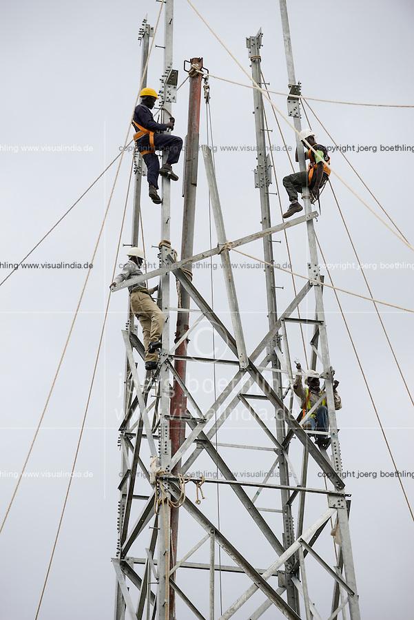 KENYA Naivasha, construction of steel tower for geothermal power plant Olkaria of KenGen the kenyan power company/ KENIA Naivasha, Aufbau eines Stahlgittermastes fuer Energienetzwerk des geothermisches Kraftwerk Olkaria des kenianischen Energieversorger KenGen