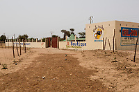 """Senegal.  Roadside Rest Stop near Diourbel (Djourbel), on the Dakar-Touba Road.  Under construction summer 2013.  """"Halal"""" on the wall denotes that meat served will have been killed in accordance with prescribed Islamic ritual."""