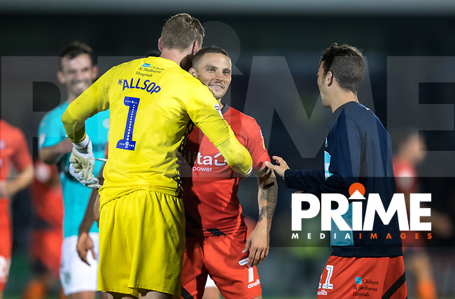 Goalkeeper Ryan Allsop of Wycombe Wanderers & Sam Saunders of Wycombe Wanderers after penalties win during the Carabao Cup 2nd round match between Wycombe Wanderers and Forest Green Rovers at Adams Park, High Wycombe, England on 28 August 2018. Photo by Andy Rowland.