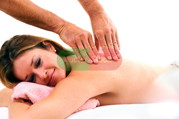 young woman having back massaged by masseur