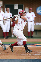 Cody Reine of the Oklahoma Sooners hits one of two of his homeruns in Game Two of the NCAA Super Regional tournament against the Virginia Cavaliers at Charlottesville, VA - 06/13/2010. Oklahoma defeated Virginia, 10-7, to tie the series after two games.  Photo By Bill Mitchell / Four Seam Images