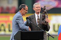 International League president Randy Mobley hands an award to Les Richmond, the son of former Rochester Red Wings player Don Richmond being inducted into the International League Hall of Fame before a game against the Norfolk Tides on July 27, 2013 at Frontier Field in Rochester, New York.  Rochester defeated Norfolk 4-2.  (Mike Janes/Four Seam Images)
