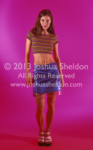 Youthful woman on colorful background