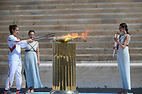 19th March 2020, Athens, Greece; The Olympic Flame, lit on Mount Olympia, is handed over officially to the  congregation from Japan, to be taken to Tokyo for the 2020 Olympic Games in July 2020. Greek athlete Katerina Stefanidi lighting the cauldron at the Panathenaic stadium, in Athens, Greece