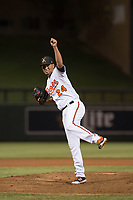 Salt River Rafters relief pitcher Luis Gonzalez (24), of the Baltimore Orioles organization, follows through on a pitch during a game against the Mesa Solar Sox on October 17, 2017 at Salt River Fields at Talking Stick in Scottsdale, Arizona. The Solar Sox defeated the Rafters 8-5. (Zachary Lucy/Four Seam Images)