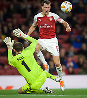 Stephan Lichtsteiner of Arsenal and Goalkeeper Bohdan Shust of Vorskla Poltava during the UEFA Europa League match group between Arsenal and Vorskla Poltava at the Emirates Stadium, London, England on 20 September 2018. Photo by Andrew Aleks / PRiME Media Images.