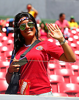 A Costa Rica supporter cheers her team on
