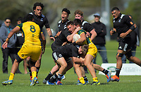 Australia's Reesjan Pasitoa is tackled during the rugby union match between New Zealand Schools and Australia Under-18s at St Paul's Collegiate in Hamilton, New Zealand on Friday, 4 October 2019. Photo: Dave Lintott / lintottphoto.co.nz