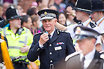 "© Joel Goodman - 07973 332324 . 23/08/2014 .  Manchester , UK . The Chief Constable of Greater Manchester Police , SIR PETER FAHY , blowing his whistle . The parade through Manchester City Centre . Manchester Pride "" Big Weekend "" in Manchester "" today ( 23rd August 2014 ) . Photo credit : Joel Goodman"