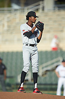 Hickory Crawdads starting pitcher Tyree Thompson (13) looks to his catcher for the sign against the Kannapolis Intimidators at Kannapolis Intimidators Stadium on May 2, 2018 in Kannapolis, North Carolina.  The Intimidators defeated the Crawdads 9-6.  (Brian Westerholt/Four Seam Images)