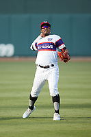 Yolbert Sanchez (2) of the Winston-Salem Rayados warms up in the outfield prior to the game against the Llamas de Hickory at Truist Stadium on July 6, 2021 in Winston-Salem, North Carolina. (Brian Westerholt/Four Seam Images)