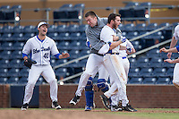 Evan Dougherty (27) of the Duke Blue Devils is mobbed by his teammates after hitting a walk-off single in the bottom of the 10th inning against the California Golden Bears at Durham Bulls Athletic Park on February 20, 2016 in Durham, North Carolina.  The Blue Devils defeated the Golden Bears 6-5 in 10 innings.  (Brian Westerholt/Four Seam Images)