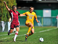 18 September 2011: University of Vermont Catamount Midfielder Brad Cole, a Sophomore from South Burlington, VT, in action against Brian Rogers of the Harvard University Crimson at Centennial Field in Burlington, Vermont. The Catamounts shut out the visiting Crimson 1-0, earning their 3rd straight victory of the 2011 season. Mandatory Credit: Ed Wolfstein Photo