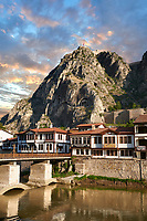 Ottoman villas of Amasya along the banks of the river Yeşilırmak, below the Pontic Royal rock tombs and mountain top ancient citadel at sunrise, Turkey