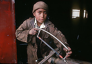 In Casablanca, Morocco, children are employed in metal idustry. Child labor as seen around the world between 1979 and 1980 - Photographer Jean Pierre Laffont, touched by the suffering of child workers, chronicled their plight in 12 countries over the course of one year.  Laffont was awarded The World Press Award and Madeline Ross Award among many others for his work.