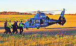 CareFlight nurses and Covington Rescue Squad personnel carry a crash victim to their helicopter for transport to Miami Valley Hospital following a crash at St. Rt. 48 and St. Rt. 185 on Wednesday.