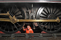 BNPS.co.uk (01202 558833)<br /> Pic: ZacharyCulpin/BNPS<br /> <br /> Train fitter, Rob Tuck works on the giant steam train wheels.<br /> <br /> Full steam ahead for Swanage Railway reopening after lockdown<br /> <br /> Volunteers are gearing up for the reopening of one of Britain's most popular heritage railways.<br /> <br /> Swanage Railway in Dorset will resume running steam trains on Monday after the government gave the green light to easing coronavirus restrictions.<br /> <br /> The Purbeck railway has spent the fallow period by doing essential maintenance work on the locomotives, tracks and signals.<br /> <br /> They are attempting to raise £65,000 to complete a new carriage shed to store ten carriages which was interrupted by the pandemic.