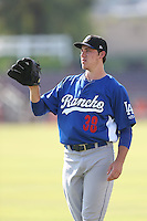 Tom Windle #38 of the Rancho Cucamonga Quakes warms up before pitching against the Inland Empire 66ers at San Manuel Stadium on August 10, 2014 in San Bernardino, California. Inland Empire defeated Rancho Cucamonga, 4-1. (Larry Goren/Four Seam Images)
